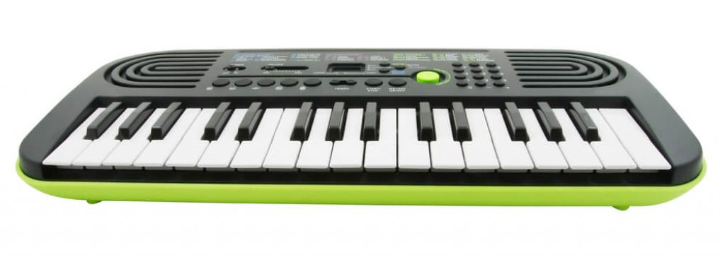 small childrens keyboard in black and green.