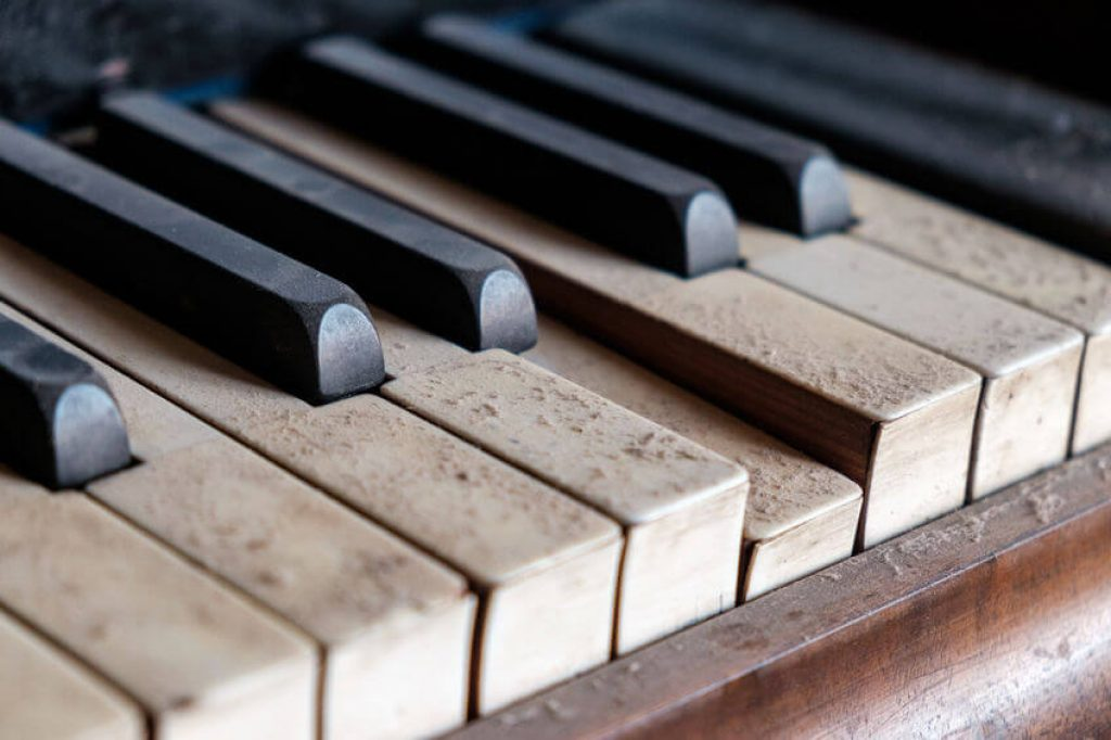 close up of dirty and dusty piano keys