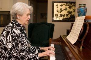 senior woman playing a piano
