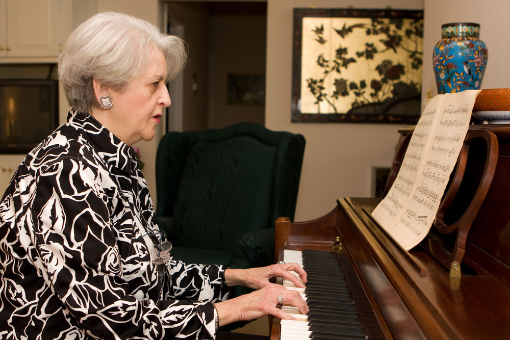 senior woman playing a piano